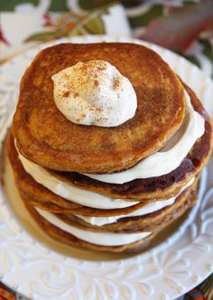 Stacked Pumpkin Pancakes with Cream Cheese Whipped Cream. Um, these look amazing! #pumpkin