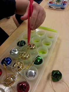"""The Crazy Pre-K Classroom: 5 Christmas Centers and a new TpT unit with a FREEBIE! - I especially like the idea of themed """"sensory bins"""" where kids have investigative tools like magnifying classes, tweezers, etc. I would add (for fun) safety goggles and something else detective-y with a chart of the senses at the station encouraging kids to test out what the objects do."""