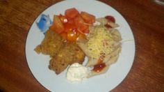 Chicken with hazelnut and pasta with ketchup and cheese, tomato salad and mayo