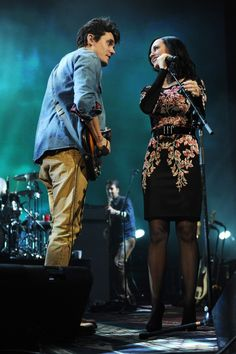 "All they need is love. Happy couple John Mayer and current GRAMMY nominee Katy Perry gaze into each other's eyes during a performance of ""Who You Love"" on Dec. 17 in New York"