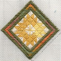 This needlepoint ornament is based on a quilt. It uses leftover threads and can be found on the blog Craft Leftovers.