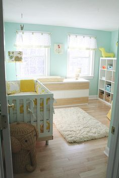Love the peaceful feel of this nursery, and the yellow bumper pad print.