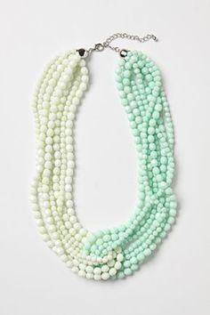 Antropologie Necklace-this would be easy to make. And with less beads so its not so heavy con dos collares de perlas y se puede poner una cinta en vez de cadenas con clasp!