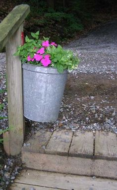 galvanized bucket on a post