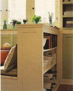 bookcase behind banquette in kitchen