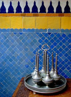 Moroccan tile wall & vintage rose water dispenser. Photographer: Maryam Montague #Moroccandesign