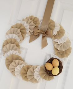 Tutorial at site for this burlap/yo yo wreath.  I'm making one minus the eggs and bird nest