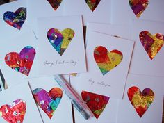 tin foil, watered down glue, tissue and some sequins...will make large hearts instead of cards