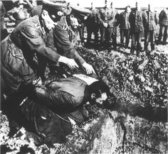German executioners shoot two Russian victims in the back of the head. Undated. Note the facial expression of the murderer on the left. These shootings would often result in the killers being splattered with the blood and brain matter of their victims. German commanders responded to this with releasing copious amounts of alcohol to the criminals with the pistols.