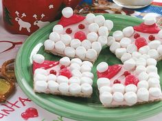 """Winter party idea: Craft and take home treat.   Cute graham cracker Santa for kids to make.    If we want to avoid """"Santa"""" or """"holiday"""" maybe just snowmen or other winter scenes, stars or snowflakes on the graham.   Edible """"glitter"""" could make it really pop!"""