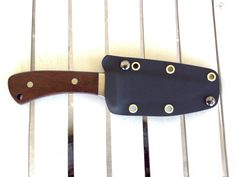Kydex sheath for a old Case hunting knife. Black Kydex with brass hardware. Starting at $15.00. Contact me about making a sheath for your knife. Handmade in U.S.A. Find us on Facebook REJck RedEyedJack custom knives of Bonifay, Florida E-mail redeyedjackcustomknives@yahoo.com