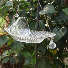 glass bird feeder made from old glassware