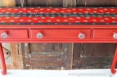 Decoupage Furniture. Red and Blue Bandana Wallpaper Border used to Decoupage a foyer table. The table is painted red and features knobs from Hobby Lobby #decoupage @hobbylobby #hobbylobby