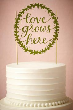 product | Love Grows Here Cake Topper from BHLDN | laser cut details