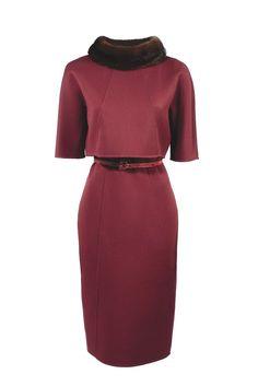 Bergdorf Goodman's Anniversary Collection: Carolina Herrera's double-face wool dress with mink collar and snakeskin belt.