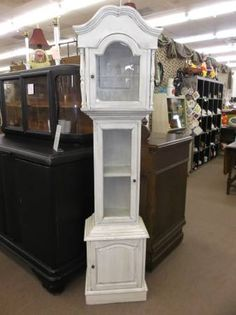 SOLD - This shabby chic grandfather clock cabinet has been made into a cute curio - nice addition to any room!  ***** In Booth A8 at Main Street Antique Mall 7260 E Main St (east of Power RD on MAIN STREET) Mesa Az 85207 **** Open 7 days a week 10:00AM-5:30PM **** Call for more information 480 924 1122 **** We Accept cash, debit, VISA, MasterCard or Discover.