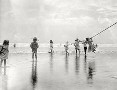 "New York circa 1905. ""Surf bathing at Coney Island. Children swinging on pier rope."" 8½ x 6½ glass negative, Detroit Publishing Company."