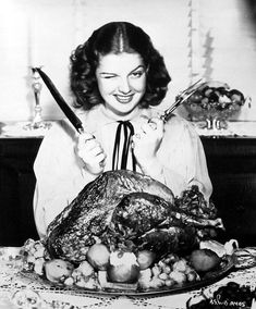 Ann Sheridan gets sets to carve the holiday bird. #turkey #Thanksgiving #Christmas #vintage #actresses