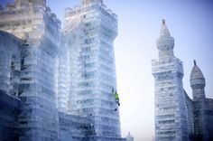 Ines Papert climbing one of the massive ice sculptures in Harbin, China.