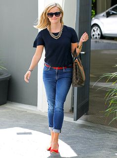 Jeans and a navy tee with pops of red - and of course a fabulous bag.