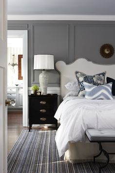 bedrooms - Para Paints - Trendsetting Style - Para Paints Elegant Boutique Para Paints Peaks and Valleys Sarah Richardson Design Vanessa Headboard gray walls wainscoting white headboard nailhead trim iron bench powder blue linen cushion striped rug