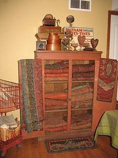 Anita White's cupboard full of wool paisley - YUM!