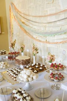 Vintage dessert table display with different bite-sized sweets - YUM! #wedding #dessert #desserttable #weddingdessert #weddingcake