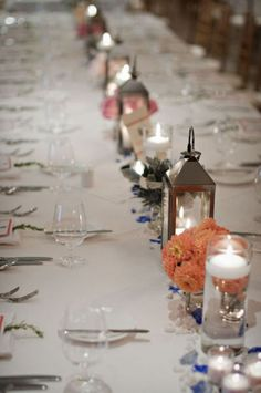 Flowers lanterns and floating candles table settings, galleries, floating candles, orange flowers, floral designs, lanterns, long tables, photography, design styles