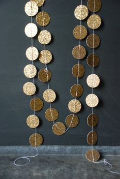 6' Gold Glitter Garland by Glitter and Grain.  These look like a fun party or Christmas decoration...