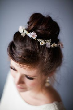 delicate pastel flower chain teamed with a high bun