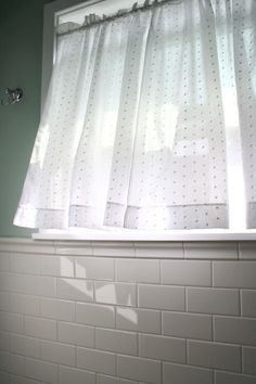 Swiss Dot Curtain. This is the quintessential bathroom window treatment, and here's why. It's a timeless classic. It's a bit old fashioned, but never stuffy. It's opaque enough for privacy, but very translucent for letting in the maximum amount of natural light.