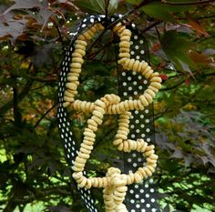 Cheerios and pipe cleaners - even the youngest little hands could manage these :) I'm hoping to make these with my sons class of 4 and 5 year old children and hang them from a tree near their classroom window.