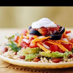 vegetarian tostada From    Brown rice and beans provide the base of this tostada. A Tex-Mex salad makes the topper. Serve as an appetizer, side dish or light meal.  Servings: 1 tostada Total: 15 mins 12345 by 2  people Add to Shopping List Add to Recipe Box  ingredients 1/3  cup  cooked brown rice 1/3  cup  canned pinto beans, black beans, or red beans, rinsed and drained 1-1/2  cups  coarsely shredded mixed greens or fresh spinach 1/2  cup  chopped tomato 2  tablespoons  chopped onion 1  tab...