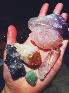looks like my collection ^-^ I see a citrine and an amethyst and maaayyybe the green is adventurine?