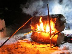 A traditional Finnish Rakovalkea fire (or gapfire), an ingenious means of getting a long-lasting, radiant fire using minimal wood and keeping the fire safely above a wet or snowy ground (details of its construction are in the linked blog entry).