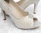 Ivory lace, pearl, and rhinestone wedding peep-toe shoes.
