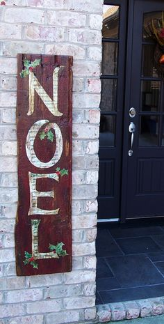 finished my Noel sign---old sheet music letters with buttons for holly berries on an old barnwood plank