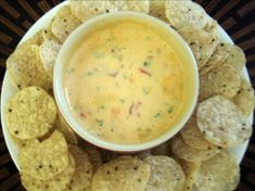 "Texas Best Cheese Dip (Chile Con Queso) from Food.com: This is a delicious cheese dip that my daughter makes. The cream cheese gives it a wonderful consistency. All the fresh ingredients make this a dip that you will be asked for over and over again! Please note I have put ""to taste"" on alot of the ingredients as it depends on how big your bunch of veggies are. If you actually get lucky enough to have any left it keeps in the fridge a good while a..."
