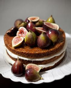 A carrot cake filled with vanilla buttercream and glazed with apricot jam featured figs.