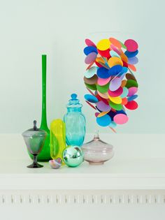 colorful paper mobile - could it be done with paint chips? #paintchips