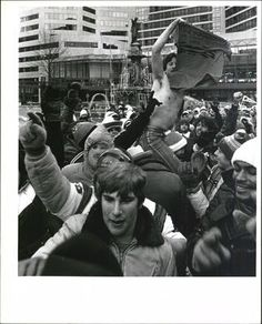 """JANUARY 10, 1982: Bengals play in the The AFC Championship. The air temperature was 9 degrees below zero. The wind chill was 59 degrees below zero, the coldest wind chill in NFL history. The game became known as """"The Freezer Bowl."""" The final score: 27-7 Bengals. Fans celebrate on Fountain Square downtown Cincinnati."""
