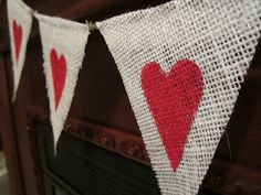 Heart bunting.  So sweet!  Put it up in your dining room for a romantic touch on a couple's dinner.