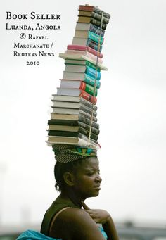 """Jan 28, 2010 – A woman carries books for sale in Luanda, Angola. © Rafael MARCHANTE ( Photographer. Lisboa, Portugal) via Reuters. View """"The day in photos"""" slide-show at link to view original image. ... The LAW requires the copyright holder be credited. COPYRIGHT LAW REQUIREMENTS: http://pinterest.com/pin/86975836525792650/  HOW TO FIND the ORIGINAL WEB SITE of an image: http://pinterest.com/pin/86975836525507659/ The Golden Rule: http://pinterest.com/pin/86975836525355452/"""