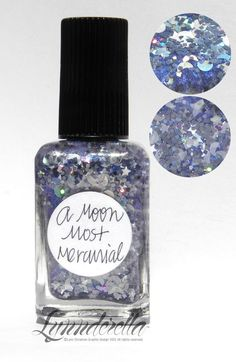 Lynnderella Limited Edition—A Moon Most Mercurial has gunmetal grey holographic moons, translucent white moons as well as assorted stars and other silvery grey and white shapes in an intense blue-shimmered clear base.
