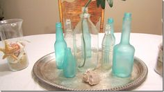 "DIY ""beach glass"" looking bottles or jars!--  Blue & Green Food Coloring ( I used the NEON COLORS FROM McCORMIC just because I like how intense the color is)   School Glue   Dish Liquid"