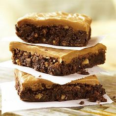 Best Cookies Recipes: Double Chocolate Brownies with Caramel Frosting | These indulgent bars are filled with toasted chopped pecans and semisweet chocolate morsels, and topped with a warm Caramel Frosting. What more can you ask out of a brownie? | #Recipes | SouthernLiving.com