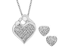 Whether a fabulous gift or a sweet self-indulgence, this charming set rewards a mother's love with an abundance of shimmering style! Sparkling heart shaped earrings join a mother's jewel pendant blanketed in icy white Swarovski crystals in a setting of sleek sterling silver. Earrings measure 3/8 by 3/8 inches, pendant measures 7/8 by 11/16 inches.Comes with a sterling silver 18-inch link chain.