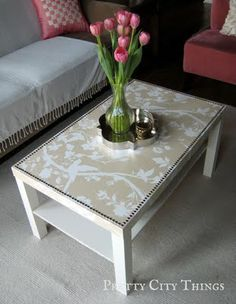 Living Pretty: Ikea Goes Glam - take a $20 table to the next level with a little wallpaper.