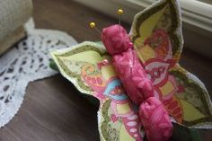 Tutorial: Butterfly pincushion · under the butterfly there is a large filled leaf also, to make the pincushion much better. It calls to use rice but I would use something much smaller.
