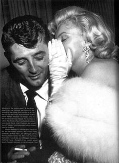 Marilyn with Robert Mitchum, yum!